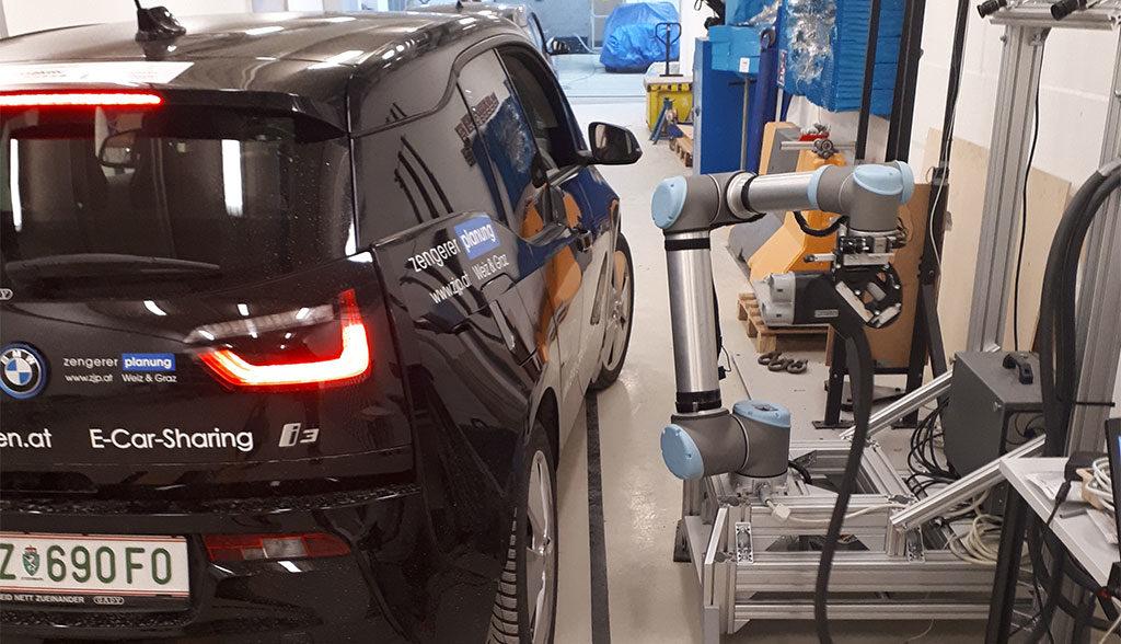 TU-Graz-Elektroauto-Laderoboter-Video